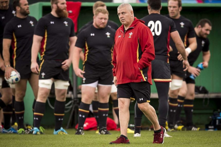 Wales' head coach Warren Gatland (centre) leading a training session at London Irish Amateur Rugby Football Club in Sunbury on Oct 8. Wales will play Australia on Oct 10.
