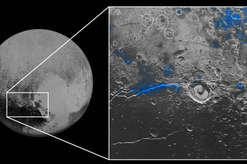 Regions with exposed water ice are highlighted in blue in this composite image from the New Horizons probe.