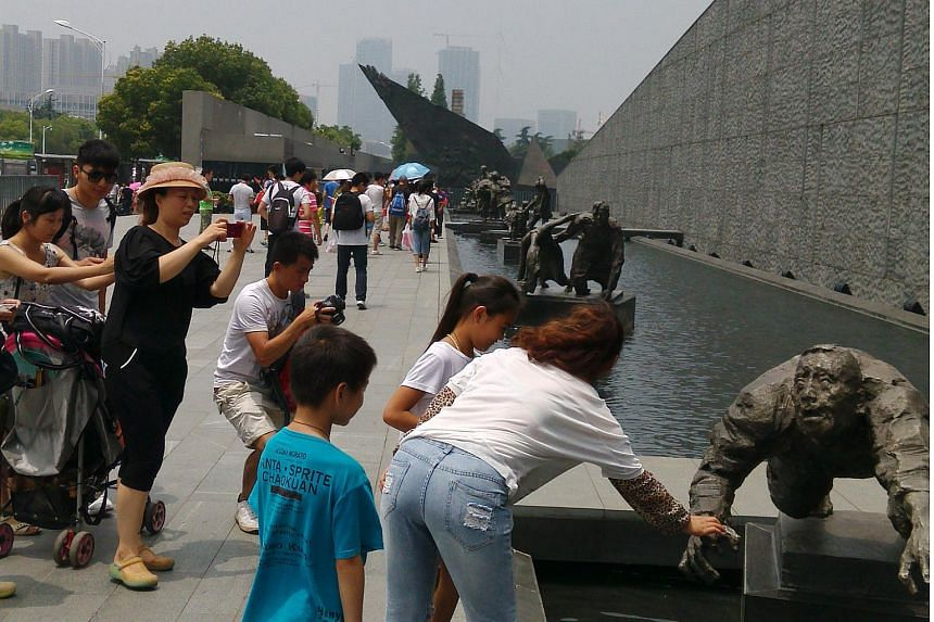 Tourists outside the Nanjing Massacre Memorial Hall.