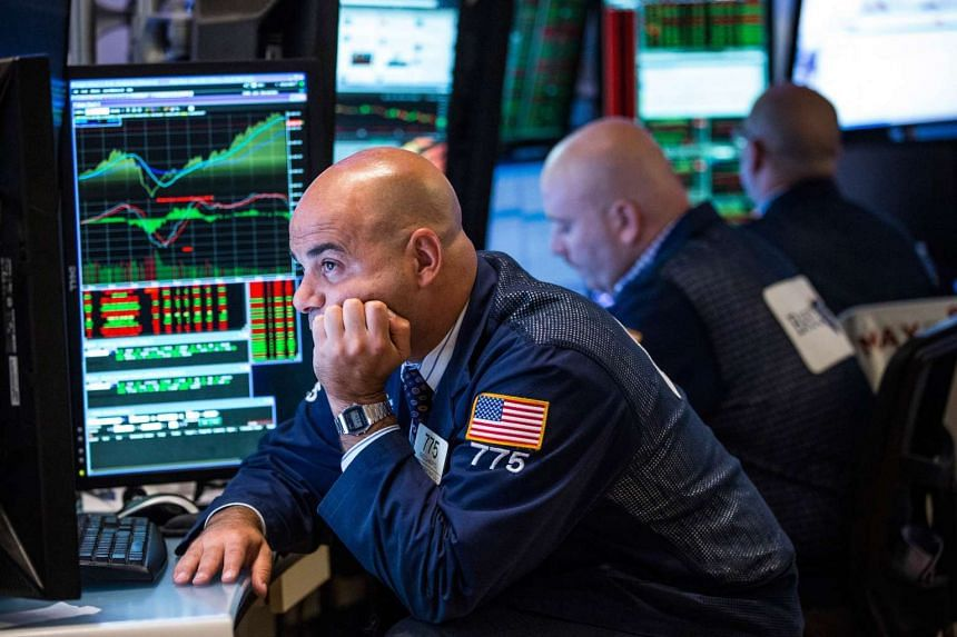 A trader works on the floor of the New York Stock Exchange after the Federal Reserve chose not raise interest rates on Sept 17, 2015 in New York, United States.