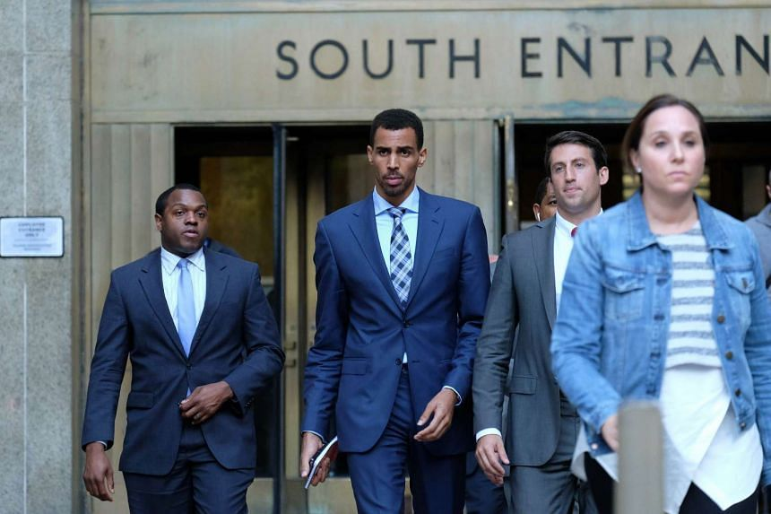 Atlanta Hawks forward Thabo Sefolosha (centre) leaves the courthouse after attending his trial in New York on Oct 7, 2015.