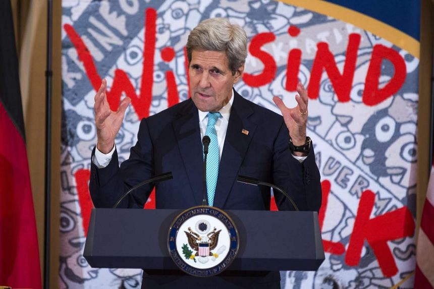 US Secretary of State John Kerry speaks at an event with German President Joachim Gauck to commemorate the arrival of a segment of the Berlin Wall that will be displayed in the U.S. Diplomacy Center at the Department of State in Washington, DC, USA o