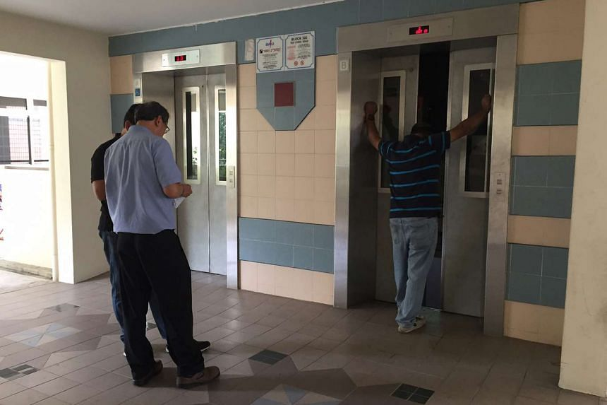 Workers are seen carrying out maintanence on lifts.
