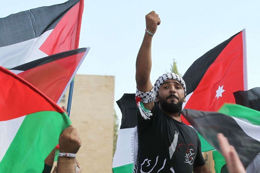 A protester gestures during a demonstration near the Israeli Embassy in the capital Amman in solidarity with the Palestinians, on Oct 9, 2015. A fresh wave of stabbings shook Israel and the West Bank, including a suspected revenge attack by a Jewish