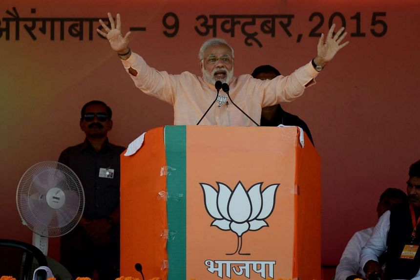 Indian PM Modi gesturing as he delivers a speech during an election rally in Aurangabad in Bihar on Oct 9, 2015.