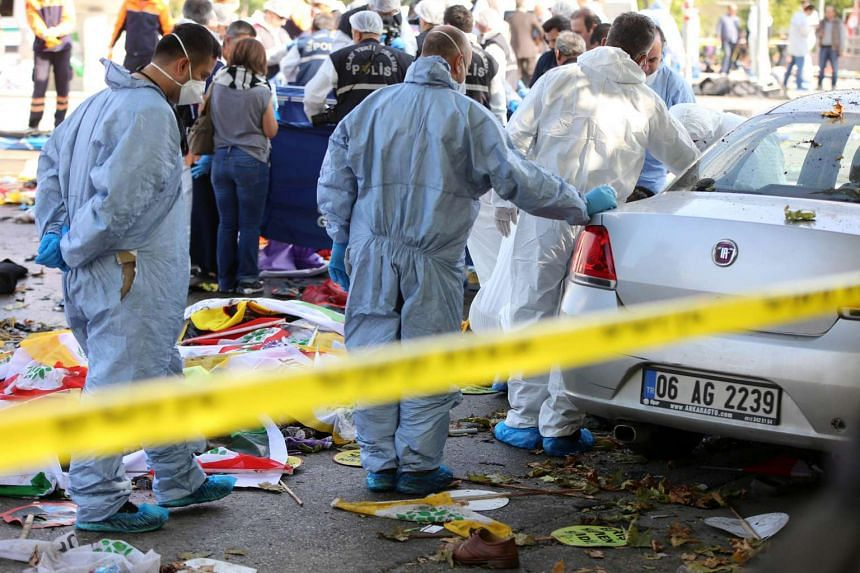 Members of a Police forensic team gather evidence at the site of twin explosions at the main train station in Turkey's capital Ankara, on Oct 10, 2015.