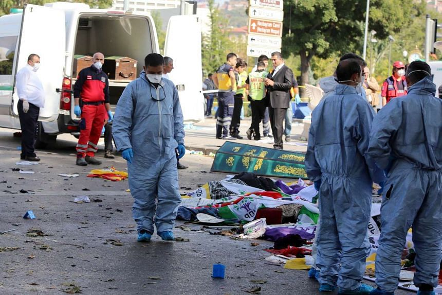 Emergency services personnel prepare to transport the bodies of victims away from the site of twin explosions at the main train station in Turkey's capital Ankara, on Oct 10, 2015.