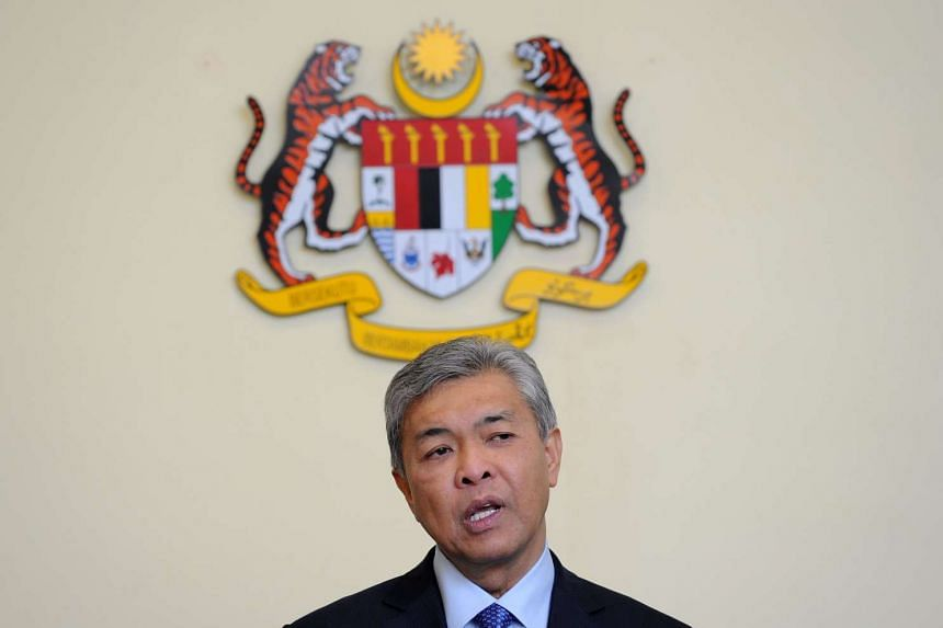 Malaysian DPM Ahmad Zahid Hamidi speaking during a press conference at the premier's office on July 28, 2015.