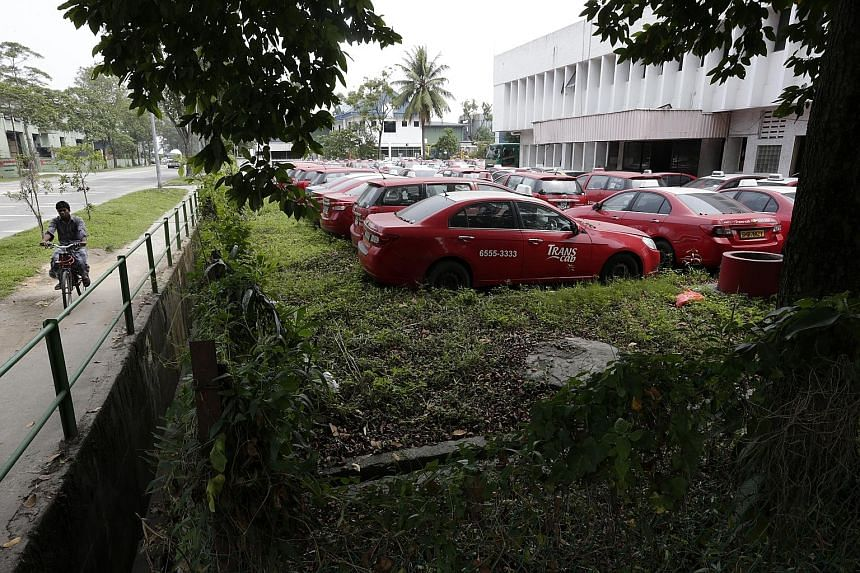 Trans-Cab taxis sitting idle in a yard in Sungei Kadut. An ST visit found as many as 800 of the operator's taxis parked in its yard, many covered in a layer of dust. Higher rental rates, stricter service norms and greater competition have prompted ma