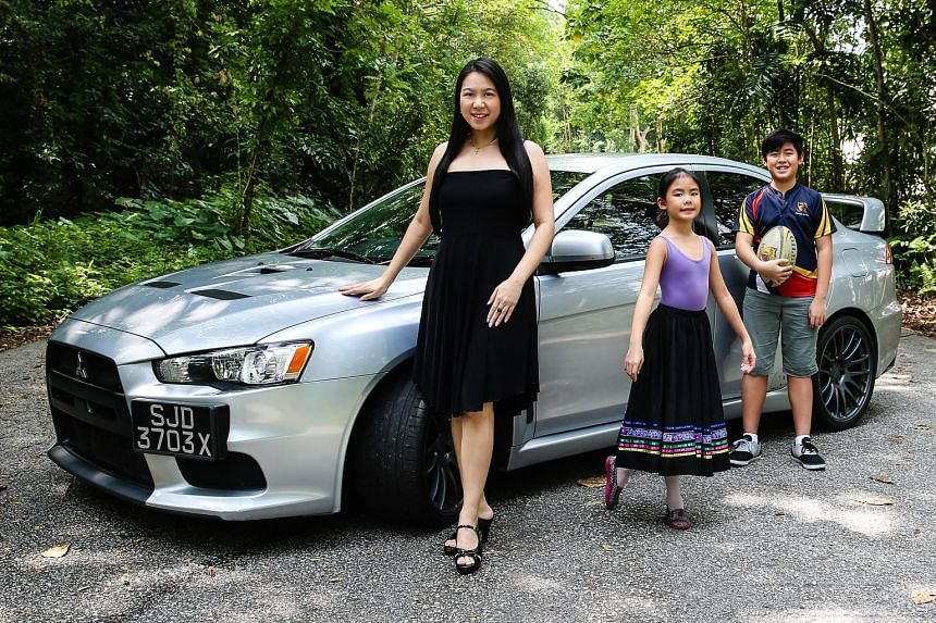 Ms Wendy Tan, assistant dean at the law faculty of the National University of Singapore, with her Mitsubishi Evo X, son Elijah and daughter Bethany.