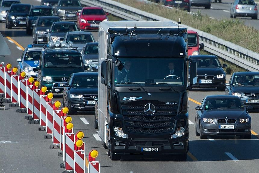 """The Mercedes-Benz Actros, fitted with the intelligent """"Highway Pilot"""" system, travelled 14km on Germany's A8 motorway with a driver in the cabin, but his hands off the steering wheel."""
