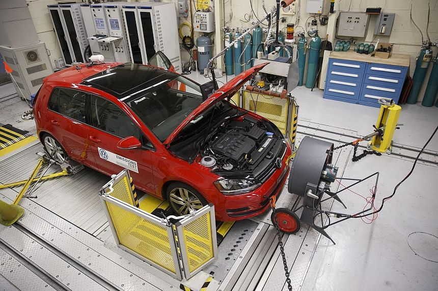 A red 2016 Volkswagen Golf TDI emissions certification vehicle waiting to be tested in California.