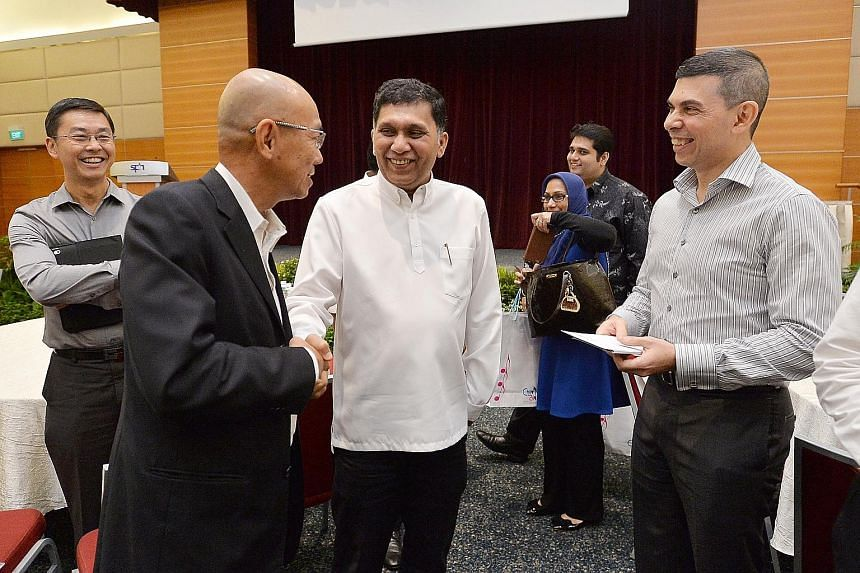At The Straits Times School Pocket Money Fund Appreciation Day yesterday were (foreground, from left) ST editor-at-large Han Fook Kwang, donor Mohamed Abdul Jaleel and ST editor Warren Fernandez. Mr Han will be stepping down as the fund's chairman, w