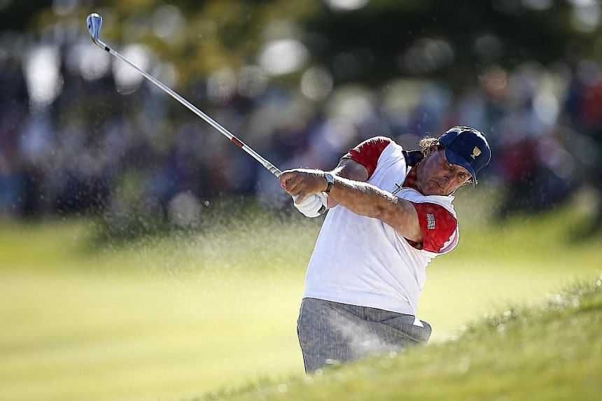 Phil Mickelson was hit by a rare infringement of the rules at the Presidents Cup but he and Zach Johnson rallied to halve the match.