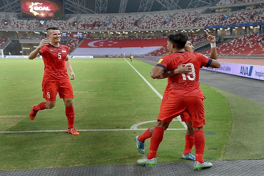Khairul Amri (back to camera), celebrating his goal with Baihakki Khaizan (left) and Faris Ramli. It turned out to be Singapore's winner against Afghanistan in Thursday night's World Cup Asian Group E qualifier at the National Stadium, watched by 7,1