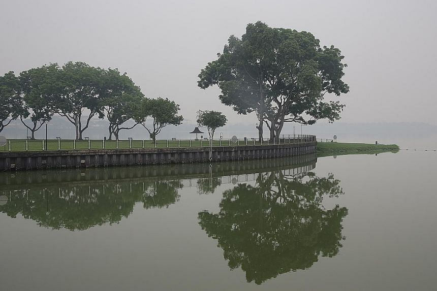 Kranji Reservoir shrouded in haze on Monday. Singapore should take the lead from the US that has laws to act against any errant firm that has a US connection.
