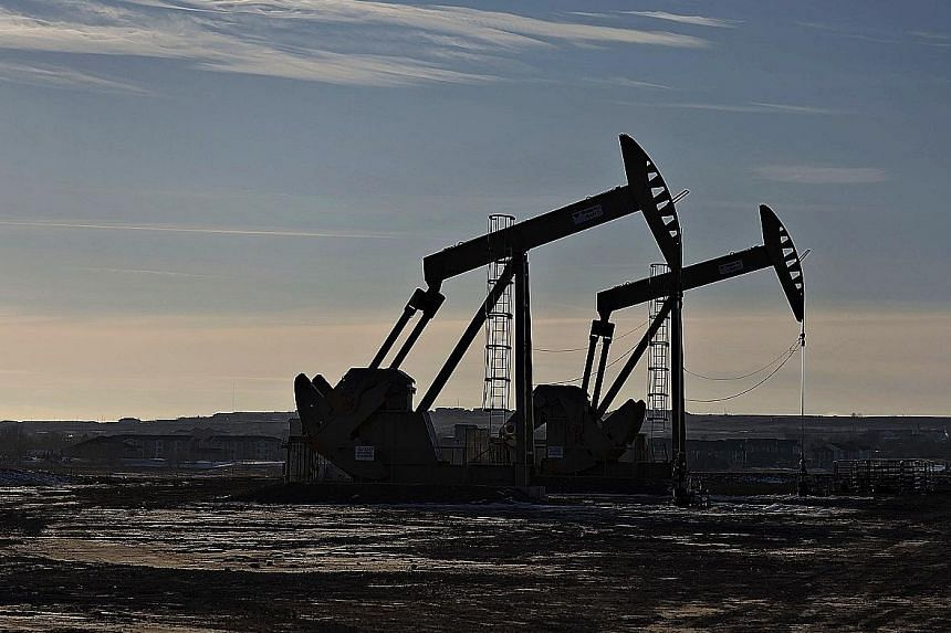 (Left) An oil well in North Dakota in the United States. As the oil prices soared, Asian currencies, particularly the Malaysian ringgit and Indonesian rupiah (above), extended their rally.