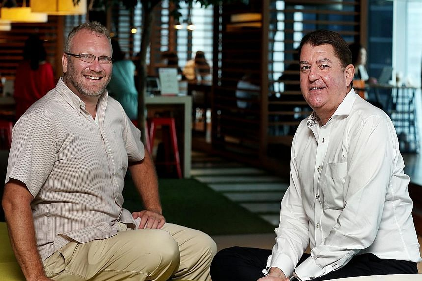 DBS chief innovation officer Neal Cross (left) says the bank is working with 145 tech start-ups and has created 120 new prototypes, while Swift's Asia-Pacific managing director, Mr Eddie Haddad, is exploring a larger role in the small-value, real-tim