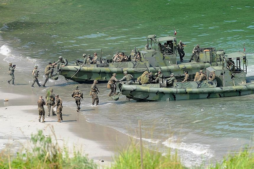 Philippine and US Marines during a beach landing drill as part of their annual joint naval exercise. The US is beefing up its role