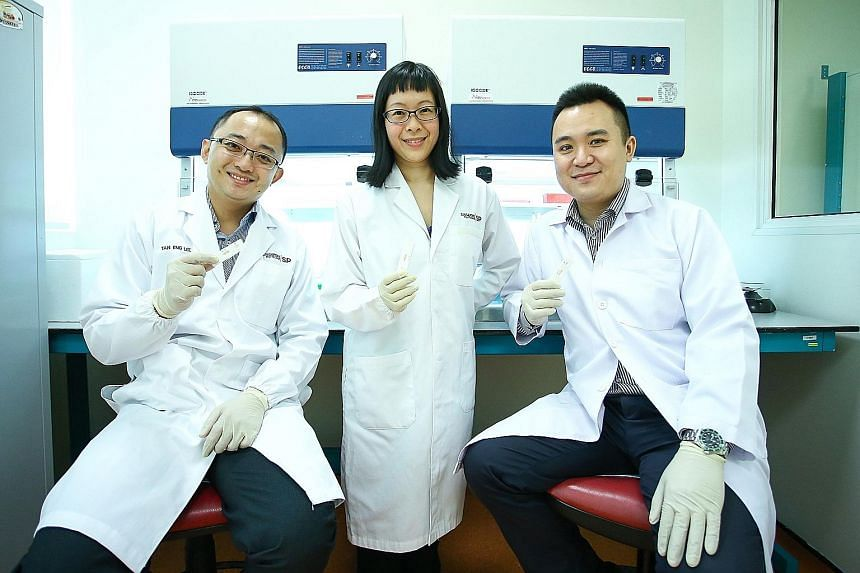 (From left) Dr Tan Eng Lee, Dr Lin Zhaoru and Dr Kevin Koh are part of a team of six working to make the HFMD kit user-friendly so it can be sold in pharmacies eventually.