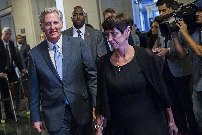 Representative Kevin McCarthy and his wife Judy arriving at a meeting of House Republicans to vote for their nominee to the post of Speaker of the House in Washington DC on Thursday.