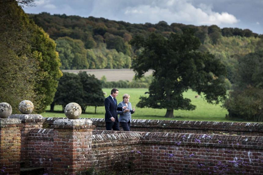 Cameron and Merkel discuss matters during a walk at Chequers, the British Prime Minister's official country residence.