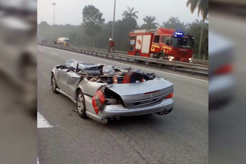 A chain reaction that started with a trailer truck crashing into a lorry led to a metal signage ripping off the top of a car, killing its driver and two passengers.