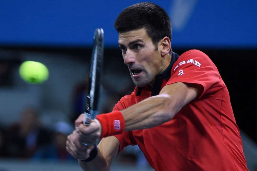 Djokovic hits a return against Ferrer during their men's singles semi-final.