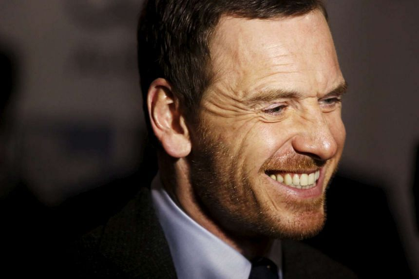Actor Michael Fassbender gives an interview before a screening of the film Steve Jobs.