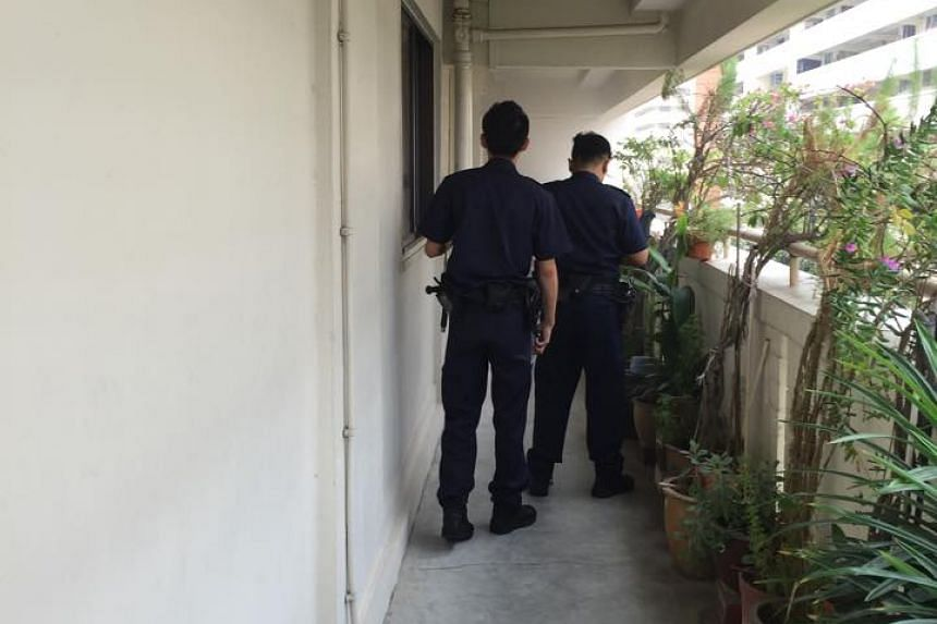 Officers outside the unit at Yishun Ring Road.
