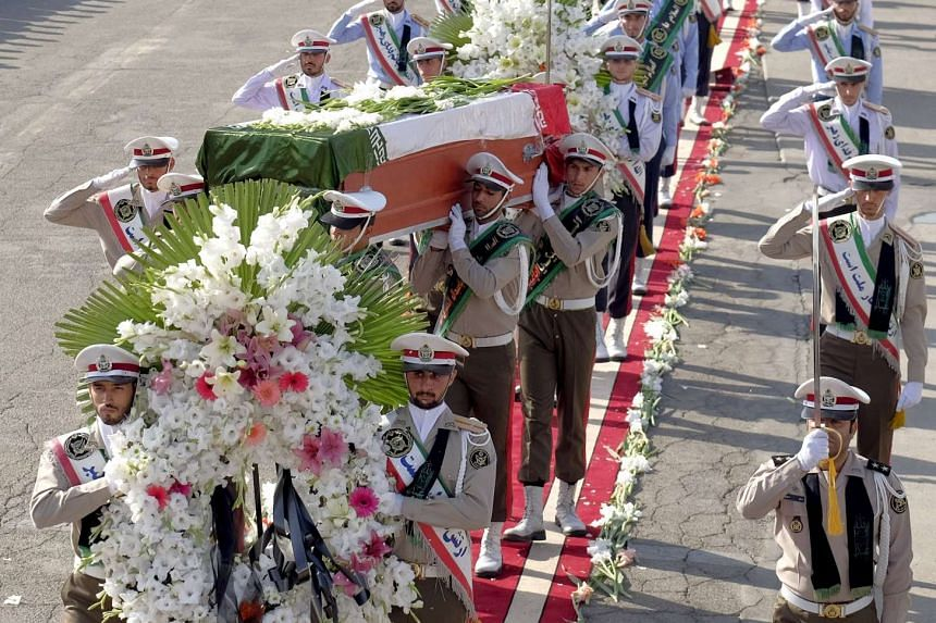Iranian soldiers carry the coffins of victims killed during the haj stampede.