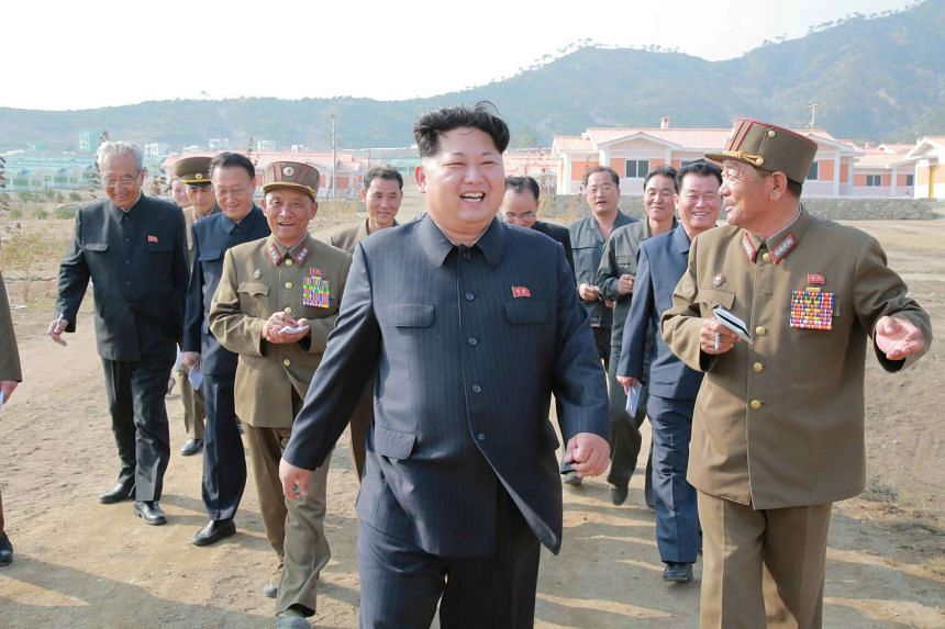 North Korean leader Kim Jong Un (centre) visiting the newly built Paekhak-dong village in Sonbong District of Rason City, on the occasion of the 70th founding anniversary of the Workers' Party of Korea on Oct 8, 2015.