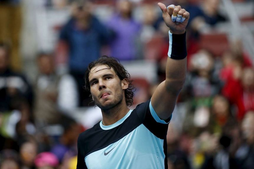 Rafael Nadal celebrating his win against Fabio Fognini to earn a place in the China Open tennis final.