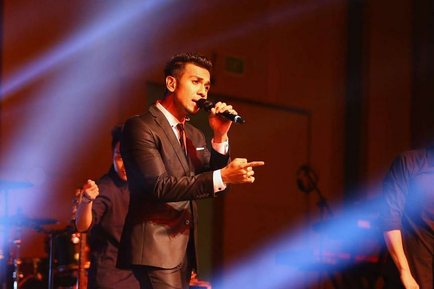 Local singer, Taufik Batisah, performing at the Jamiyah Mega Charity Concert in Jul 2015.