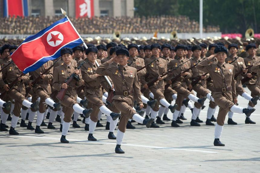 North Korean soldiers marching during a military parade past Kim Il Sung Square marking the 60th anniversary of the Korean war armistice in Pyongyang on July 27, 2013.