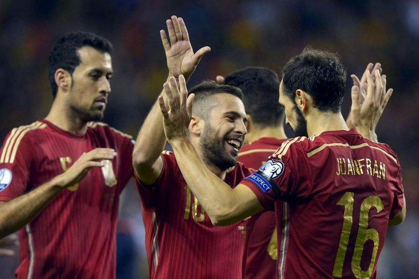 (From left) Spain's Sergio Busquets, Jordi Alba and Juanfran Torres celebrate a goal.
