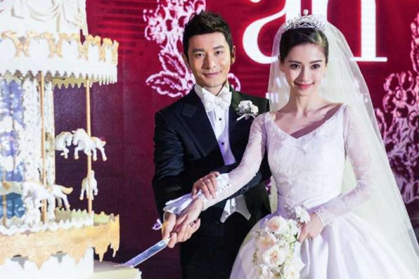 Actors Huang Xiaoming and Angelababy at the wedding banquet in Shanghai.