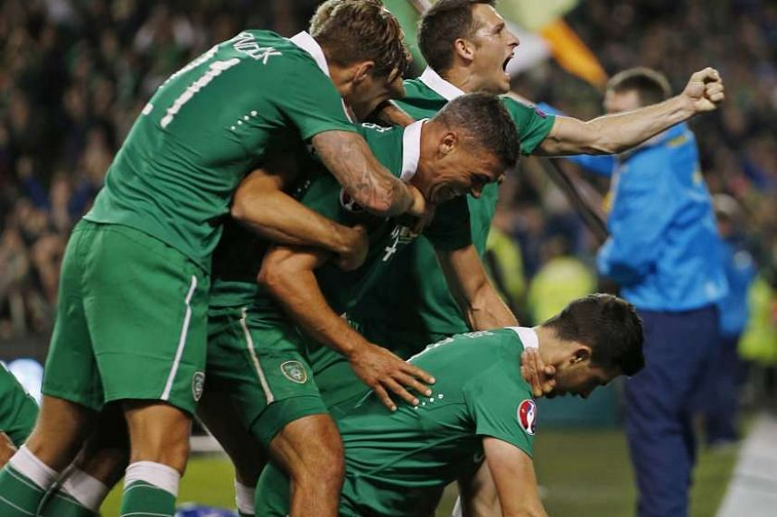 Shane Long gives the home supporters plenty to shout about as his goal against Germany earns a shock 1-0 victory that guarantees Ireland at least a play-off spot for Euro 2016.
