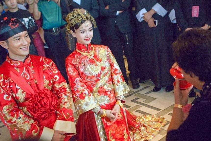 Actors Huang Xiaoming and Angelababy at the traditional tea ceremony held earlier in the day at a hotel.