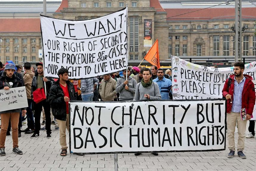 Refugees in Leipzig during a rally on Thursday calling for better treatment and speedier processing of their cases. It has been reported that Berlin's estimates of arrivals this year have been raised to 1.5 million from 800,000 earlier.