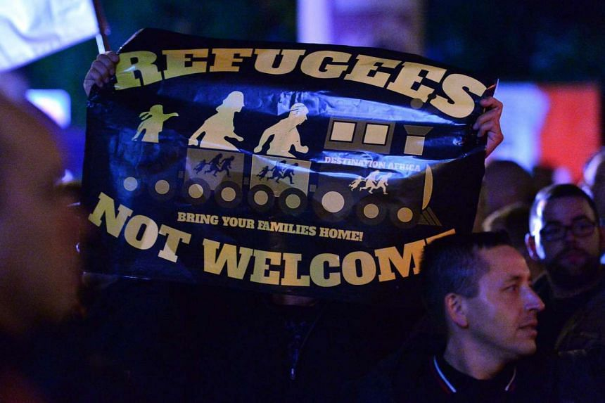 Anti-migrant demonstrators rallying in Erfurt on Wednesday. About 40 per cent of asylum seekers in Germany have some form of mental illness, said a psychotherapists' association.