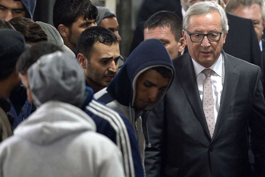 European Commission president Jean-Claude Juncker (right) mingles with migrants in Passau, southern Germany, on Thursday