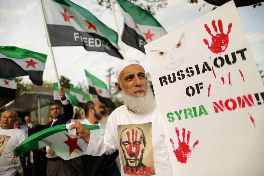 About 100 people gathering outside the Russian embassy to protest against President Vladamir Putin and his country's involvement in Syria on Oct 9, 2015 in Washington, DC.