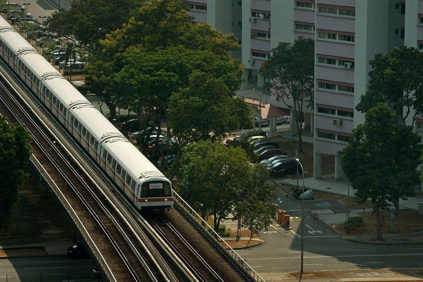 An SMRT train approaching Paya Lebar MRT station.