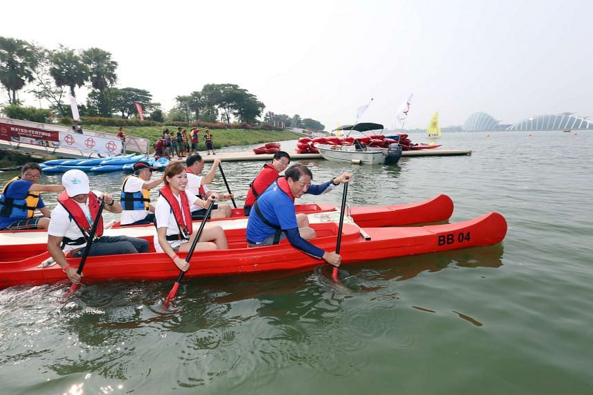 DPM Teo Chee Hean, Mr Ang (back, in red shirt) and Ms Koh trying Bell Boating along Kallang Basin on Oct 11, 2015.