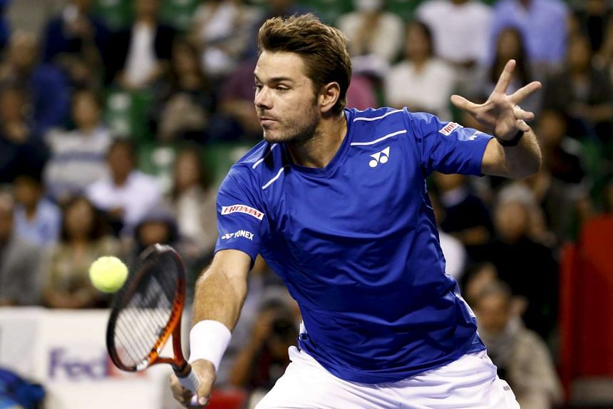 Stan Wawrinka of Switzerland returns the ball to Benoit Paire of France during their men's singles final of the Japan Open tennis championships in Tokyo on Oct 11, 2015.