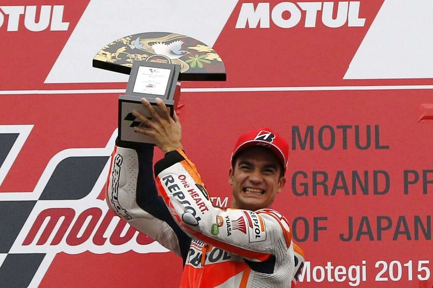 Honda MotoGP rider Dani Pedrosa of Spain celebrating on the podium after winning the Japanese Grand Prix at the Twin Ring Motegi circuit in Motegi, north of Tokyo, on Oct 11, 2015.