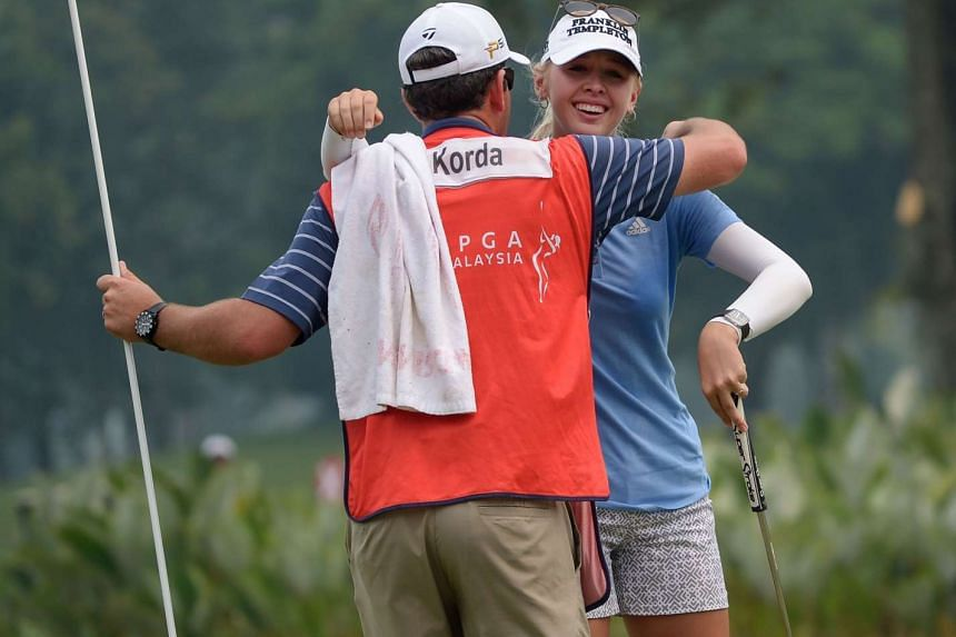 Jessica Korda of the US (right) hugs her caddie Kyle Bradley after she won the Sime Darby LPGA Malaysia 2015 golf tournament at the Kuala Lumpur Golf and Country Club on Oct 11, 2015.