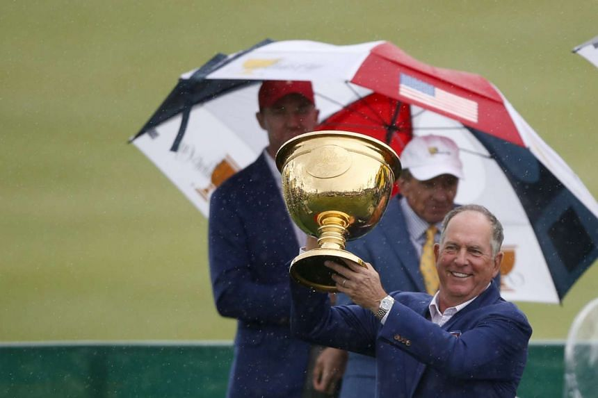 US team captain Jay Haas holds up the Presidents Cup during the closing ceremony of the 2015 Presidents Cup golf tournament at the Jack Nicklaus Golf Club in Incheon, South Korea, on Oct 10, 2015.