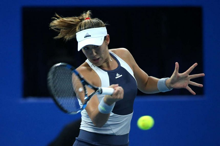 Garbine Muguruza of Spain climbed to fourth in the world rankings after defeating Switzerland's Timea Bacsinszky to win the China Open on Sunday, Oct 11, 2015.